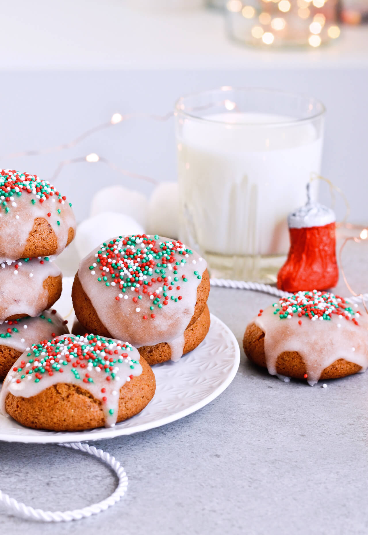 Recipe for Sugar glazed lebkuchen (German Christmas cookies), the perfect spicy and sweet cookies. Great for Christmas or any cold month, they're filled with honey and wonderful, aromatic spices. The festive sprinkles add that extra holiday touch. | @mitzyathome mitzyathome.com