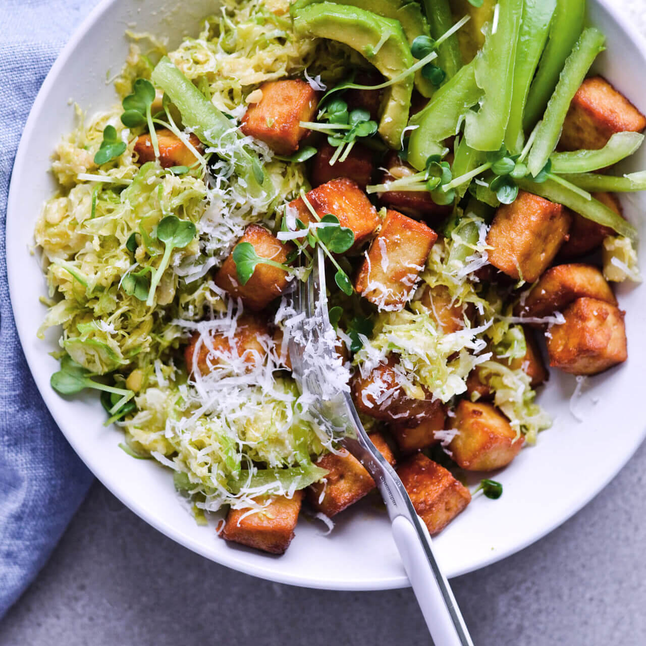 Recipe for Crispy tofu shaved brussels sprout salad with honey mustard dressing, pine nuts and Parmesan. Easy to make, very filling and vegetarian meal. | mitzyathome.com
